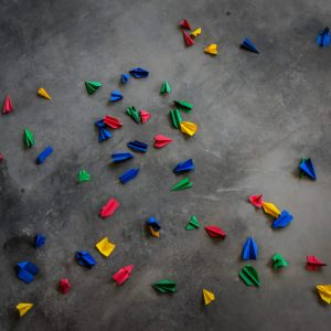 Photo: Origamis on concrete pavement by Reza Rostampisheh @ unsplash